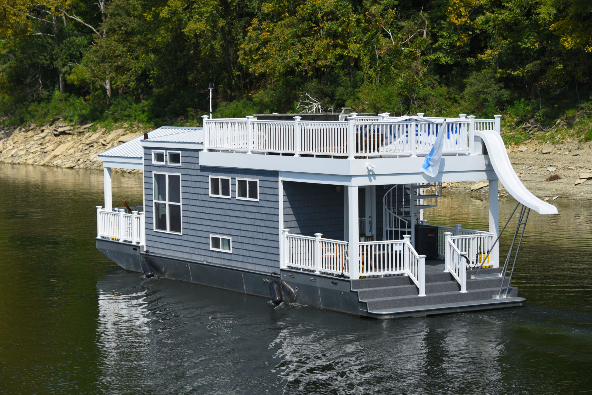 Tiny boat harbor cottage houseboats for Boat house plans pictures